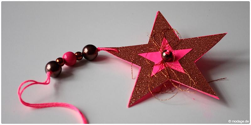 Sterne aus Papier basteln Sterne basteln Weihnachtssterne Plissee basteln Anleitung neonpink Garnundmehr 9